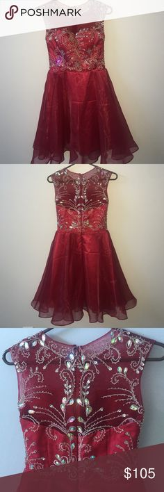 Homecoming/Special Occasion Dress This is a beautiful dress that has NEVER BEEN WORN before. I took the tags off to try on. It is a maroon color with an intricately beaded designed front/back. The skirt has 2 layers; sheer one & an opaque one. Not sure where I got this dress from but I remember trying it on and being devastated that it didnt fit my dimensions. It says its a size 2 but in my opinion it fits like a 0...if you have a larger bust this dress may not be comfortable for you. has…