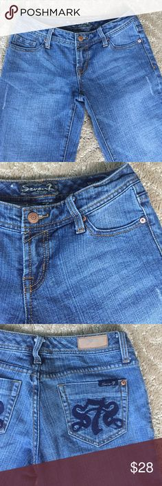 """SEVEN 7: RETRO WIDE LEG LOW RISE JEANS. SIZE 24 SUPER COOL RETRO 70's feel, distress light wash blue jeans. 11.5"""" wide leg, low rise, with a 32"""" inseam, waist 28"""". 78% cotton, 20% polyester, 2% spandex machine washable med weight fabric. Navy blue logo embroidery on back two pockets . Logo copper hardware. Tight fit in PERFECT CONDITION LIKE NEW ! SEVEN 7 Jeans Flare & Wide Leg"""