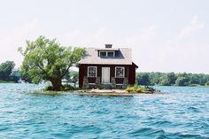 Not a houseboat, but someday this house will wish it was, as it looks to be built on a sandbar that's being eaten up by the lake.