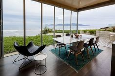 A Kapiti Coast beach house has been designed around difficult topography – and a phenomenal vista – to great effect.