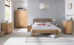 A statement grey wall adds edge to a bedroom. (Furniture featured is our Casa Oak Bedroom range from Bentley Designs)