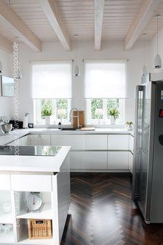 white kitchen, dark wood floor, light wood ceiling