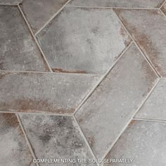 The Merola Tile D'Anticatto Grigio Chevron Left in. Porcelain Floor and Wall Tile emanates rustic charm. The elongated rhombus shape offers a range of design options and can be paired Patio Tiles, Outdoor Tiles, Balcony Tiles, Bathroom Flooring, Kitchen Flooring, Porch Flooring, Brick Flooring, Outdoor Flooring, Kitchen Tile