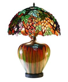 @Overstock.com - Reminiscent of the finest designs attributed to Louis Tiffany almost a century ago, this beautiful stained glass Tiffany style lamp evokes a bygone era but still looks great in modern homes. Fine copper foil and a ceramic base complete this luxury lamp.http://www.overstock.com/Home-Garden/Tiffany-Style-Grape-Lamp-With-Ceramic-Base/2620982/product.html?CID=214117 $164.99