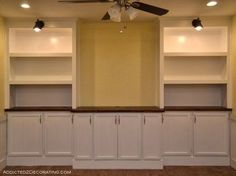 diy bookcase media wall, diy, painted furniture, shelving ideas, woodworking projects, The finished bookcase media wall I left the middle section open for a large flat screen t v There s a hole in the countertop towards the wall for cords and an electrical outlet accessible in the middle cabinet