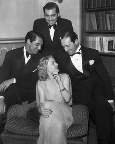 Carole Lombard at a party at the home of former co-star Ricardo Cortez on her right. Two other former co-stars hover: Cary Grant and Clark Gable