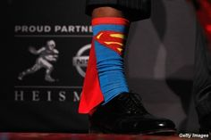 Yup, that's my quarterback. Rockin' the Heisman trophy and superman socks (with cape attached). Sic 'em Bears!