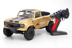 Outlaw Rampage Pro Outlaw Rampage Pro GOLD Realistic truck delivers the optimal combination of style and performance for the Trophy Truck, Roll Cage, Radio Control, Monster Trucks, Gold, Yellow