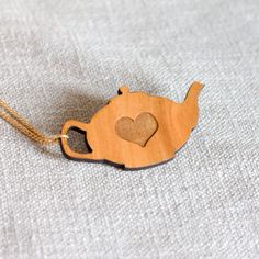 Hey, I found this really awesome Etsy listing at https://www.etsy.com/listing/86405033/teapot-necklace-tea-love-heart-laser-cut