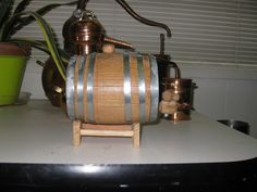 Miniature Oak Barrel for aging spirits. One liter capacity. Age vodka to 'whiskey' within weeks and months. http://pict.com/p/BTZ