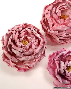 Peonies from paper - would be fabulous on top of butcher paper, with some doilies and tea lights as a centerpiece