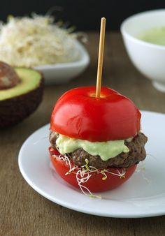 Tomato as a bun - genius!  This recipe says to use meat, but this could easily be done with walnut/lentil meatball recipe.  Drizzle with a great cashew aioli and skewer it...  perfect appetizer or small plate meal.