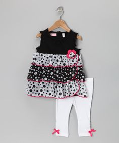As adorable as it is easy to coordinate, this delightful duo will have girls looking and feeling their absolute best. Simply slip on the tunic, slide on the stretchy bottoms and start that day! Each piece is great for mixing and matching, too.Includes tunic and leggingsTunic: 60% cotton / 40% polyesterRuffles and lining...