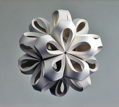 These paper sculptures made by Richard Sweeney would make cute as Christmas decorations.