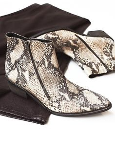 Crossings Ankle Boot   Western inspired luxe leather ankle boots with a pointy toe and exposed zipper detailing.  Stacked wooden heel.