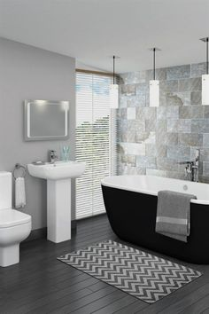 Romantic Bathroom Features An Accent Wall Clad In Wavy
