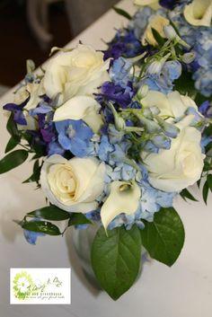 Bridesmaid Bouquet of Blue Hydrangea, White Roses, and Blue Delphinium.