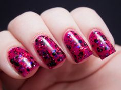 Happy Hands Nail Polish - Metal Heart is a raspberry jelly is filled with pink, purple, and black glitters, plus micro red holographic glitter and blue-purple iridescent glitters.