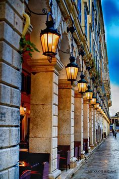 """in Corfu, façade of the emblematic """"Listón"""" café-restaurant. (Corfu is called Kérkyra in Greek and counts among the Ionian islands in West Greece. Corfu Town, Corfu Island, Corfu Greece, Purple Sunset, Local Tour, Street Lamp, Walking Tour, Places To See, Tours"""