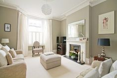 Traditional Neutral Living Room A traditional living room with walls painted in Farrow and Ball's hardwick white. Neutral furnishings, inviting fireplace with beveled rectangular mirror above the fireplace. Living Room Green, Living Room Paint, New Living Room, Home And Living, Farrow And Ball Living Room, Living Room Decor For 2018, Small Living, 1930s Living Room, Taupe Living Room