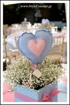 Such a cute centerpiece for boy & girl twins! Based on an inspiration of pale blue and pink along with handmade fabric hearts we created a baptism concept totally based on that.