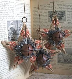 3 Handmade Star Ornaments. I wouldn't use tensile n the middle it makes it look to modern. If use jute rope.