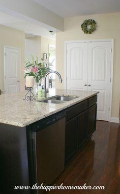 Giallo ornamental granite with espresso cabinets for basement bar