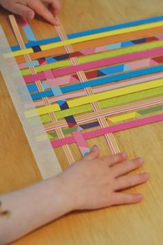 Paper strip weaving with colorful, printed paper