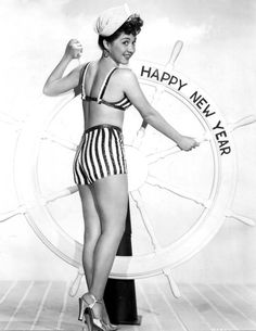 Olga San Juan poses as a sailor and takes hold of the mast for the New Year; 1946 | rusted shutter | #vintage #1940s #newyearseve