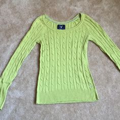 "American Eagle Scoop Neck Lime Sweater American Eagle Outfitters (AE) Size M. Wide scoop neck cable knit sweater. 50% cotton 20% rayon, 19% nylon 8% wool 2% other.  Waist 13"", Length 23"" Arm Length 25"". Great condition just a couple little fuzzier on the hems not noticeable when on, looks new. Arms can be cuffed to adjust length American Eagle Outfitters Sweaters Crew & Scoop Necks"
