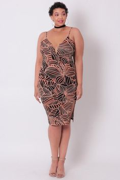 This plus size, stretch texturized crepe knit dress features a v-neck with an inserted wire for an improved quality and spaghetti straps, all-over tribal print design, princess seams for a tailored lo