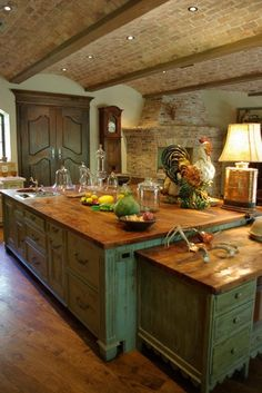 Country French Decor. I love the brick and wood, but not really a big fan of the color of the cabinets