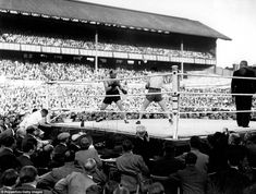It's not just been football staged at White Hart Lane over the years as Jack London (left) and Bruce Woodcock compete in a boxing match in front a large crowd in July 1945. Woodcock won in round six to take the British and Empire heavyweight tiles