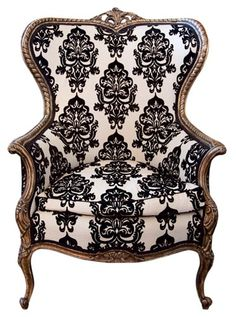19th Century Louis XVI Guilded Wing Chair.