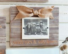 """Mud Pie Sandy Toes Photo Frame: Distressed wood frame reads """"sandy toes & salty kisses"""" and is accented with burlap bow. Reclaimed Wood Frames, Reclaimed Wood Projects, Wood Picture Frames, Picture On Wood, Framed Burlap, Sandy Toes, Crafts With Pictures, Burlap Bows, Mud Pie"""