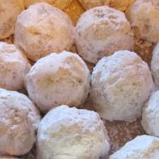Pecan Balls (Christmas Cookies)  Melts in your mouth. These are a refreshing change from those too sweet Christmas Cookies.  Ingredients  ½ 	lb. butter  4 	Tbsp. sugar  2 	C ground pecans  2 	C flour  1 	tsp. vanilla  Directions  Cream sugar and butter, then add other ingredients. Make into small balls and bake at 375º F. until lightly browned. Shake in powdered sugar just before serving