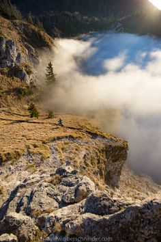 Trail Running above the Clouds by Christoph Oberschneider