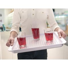 Joseph Joseph Grip Tray! balancing drinks will never be an issue again with this silicone dotted Tray - available in pink, green and white.