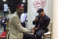 ZC Vice President of Operations Waheed Rasheed speaking with filmmaker/ photographer Mustafa Davis at the 2013 ISNA convention.