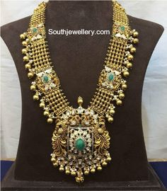 Beautiful antique gold long haaram with gold ball hangings. LOng haaram with dancing peacock motifs. Long haaram with lotus flower design pendant. For More info WhatsApp : 99660 00001 Gold Temple Jewellery, Gold Jewellery Design, Antique Jewellery, Gold Jewelry Simple, Simple Necklace, Bridal Jewelry, Mom Jewelry, Jewelery, Indian Jewelry