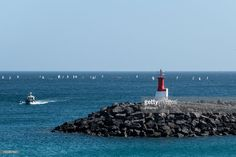 Beacon on jetty. Port of Playa Blanca, Lanzarote, Canary Islands, Spain
