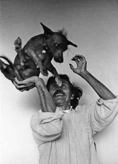 Francisco Toledo Juggling a Dog  by Gaciela Iturbide