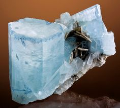 Rich blue Aquamarine with a unique stepping along the top edges with Muscovite, from Nuristan Province of Afghanistan