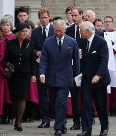 In mourning: The Prince of Wales accompanied by the Duchess of Cornwall, the Duke of Cambridge and Prince Harry arrive at the Cathedral of Saint Mary and Saint Helen in Brentwood, Essex, for the funeral of Hugh van Cutsem
