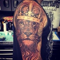 stunning Lion tattoo on upper sleeve.