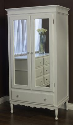 I think I'm going to try to copycat this. Buy a cheapie Kmart  armoire repainted white and add cheap mirrors to the doors.