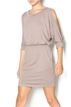 This soft jersey dress has an elastic waistband, pockets at the hips, and cutout sleeves at the shoulders. Dress up with a statement necklace, layered bracelets, and booties or heels.   Jersey Pocket Dress by Interi. Clothing - Dresses - Casual Cincinnati, Ohio
