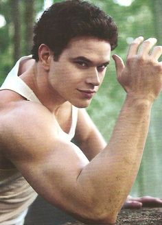 """Emmett from Twilight portrays the """"strong"""" member of the Cullen family.  He shows hyper-masculinity in both the books and the movies.  Whenever there needs protection or muscles, Emmett is the first one the family goes to."""