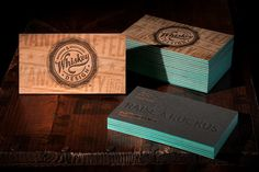 New @Whiskey Wall Wall Design biz cards: wood veneer laminated to paper with a teal center, screenprint varnish on the wood, letterpress and finally foil stamped contact info.