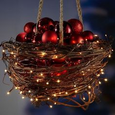 Fill a basket with your Christmas balls. Wrap a string light around the basket. This hanging ornaments planter will make your outdoor very attractive. I'd love to see blue with light blue ornaments for this idea.